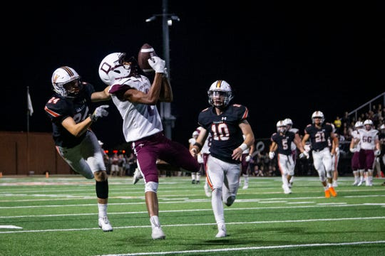 Dowling Catholic's Louis Brooks (2) catches a pass for a touchdown to make the score 20-22 during their football game at Valley Stadium on Friday, Sept. 6, 2019 in Des Moines. Valley would go on to defeat Dowling Catholic 29-22.