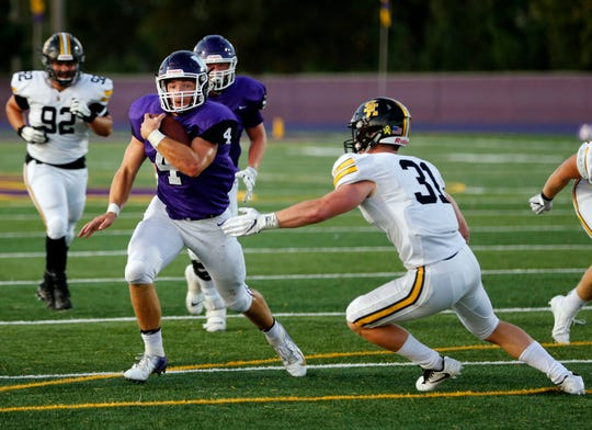 Waukee quarterback Mitch Randall runs the ball for a touchdown during a game against South East Polk in Waukee Friday, Sept. 6, 2019.