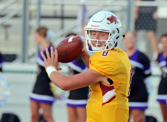 Ankeny High junior quarterback Jase Bauer (8) spots an open receiver as the No. 9 Johnston Dragons battle against the Ankeny Hawks in the first half of play during the Class 4A game on Friday, September 6, 2019 at Ankeny Stadium.