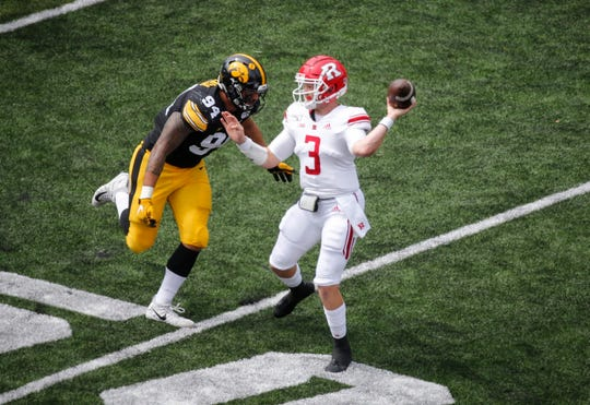 Iowa junior defensive end A.J. Epenesa forces Rutgers quarterback McClane Carter to get rid of the ball in the second quarter on Saturday, Sept. 7, 2019 at Kinnick Stadium in Iowa City.