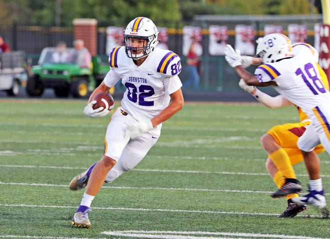 Johnston junior wide receiver Tyler Moore (82) breaks free  as the No. 9 Johnston Dragons battle against the Ankeny Hawks in the first half of play during the Class 4A game on Friday, September 6, 2019 at Ankeny Stadium.