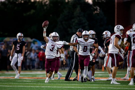 Dowling Catholic's Michael Keough (3) comes up with the ball after a punt during their football game at Valley Stadium on Friday, Sept. 6, 2019, in Des Moines.