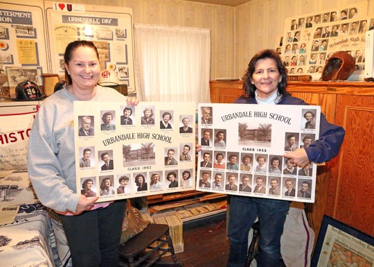 Victoria Noble, left, and her cousin, Kim McCarl, point to their mothers' graduation photos which are stored at the Urbandale Historical Society museum inside the Olmsted-Urban House.