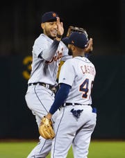 Tigers center fielder Victor Reyes high fives shortstop Willi Castro after the Tigers' 5-4 win on Friday, Sept. 6, 2019, in Oakland, Calif.