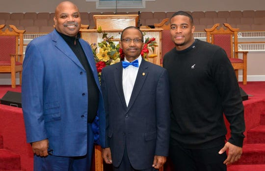 Trey Flowers, right, with pastor O. Wendell Davis, middle, and his father Robert Flowers, left.