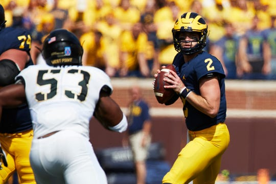 Michigan quarterback Shea Patterson looks to pass in the first half against Army on Sept. 7, 2019 in Ann Arbor.