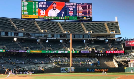 The scoreboard at the Oakland-Alameda County Coliseum welcomes fans to Comerica Park for the continuation of a game suspended by rain earlier in the season, between the Tigers and the Athletics on Friday.