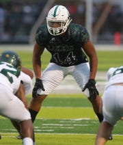 West Bloomfield Lakers' Cornell Wheeler lines up against the Birmingham Groves Falcons on Friday, Sept. 6, 2019 at West Bloomfield high school.