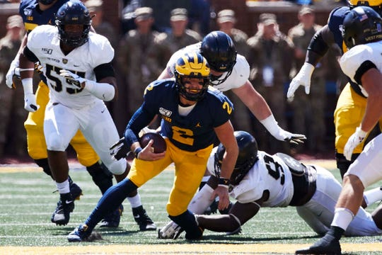 Michigan quarterback Shea Patterson runs the ball in the first half against Army on Sept. 7, 2019 in Ann Arbor.