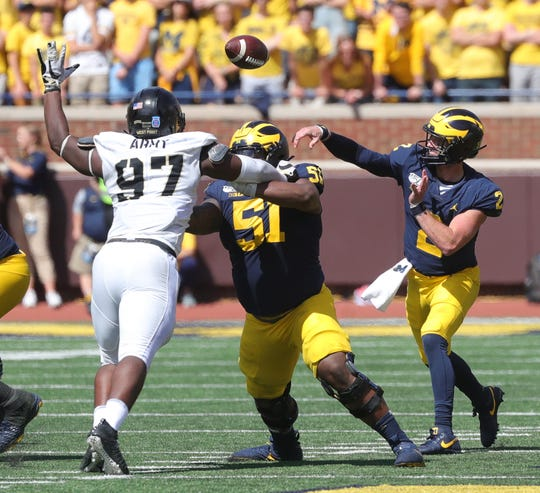 Michigan Wolverines quarterback Shea Patterson (2) passes against the Army Black Knights first half action Saturday September 7, 2019 at Michigan Stadium in Ann Arbor, Mich.