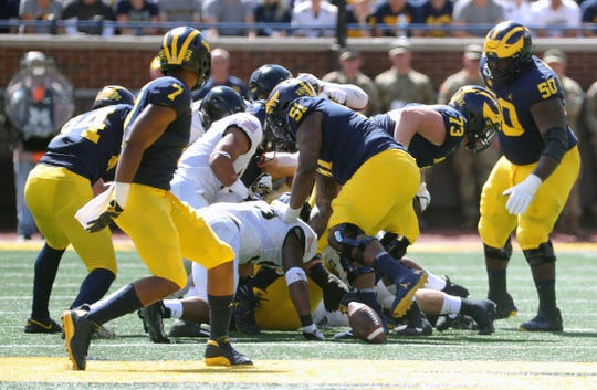 Michigan Wolverines lose a third fumble to the Army Black Knights during first half action Saturday, September 7, 2019 at Michigan Stadium in Ann Arbor, Mich.