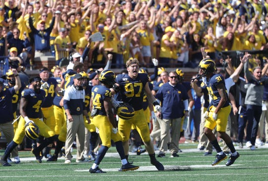Michigan Wolverines celebrate the 24-21 win against the Army Black Knights Saturday September 7, 2019 at Michigan Stadium in Ann Arbor, Mich.