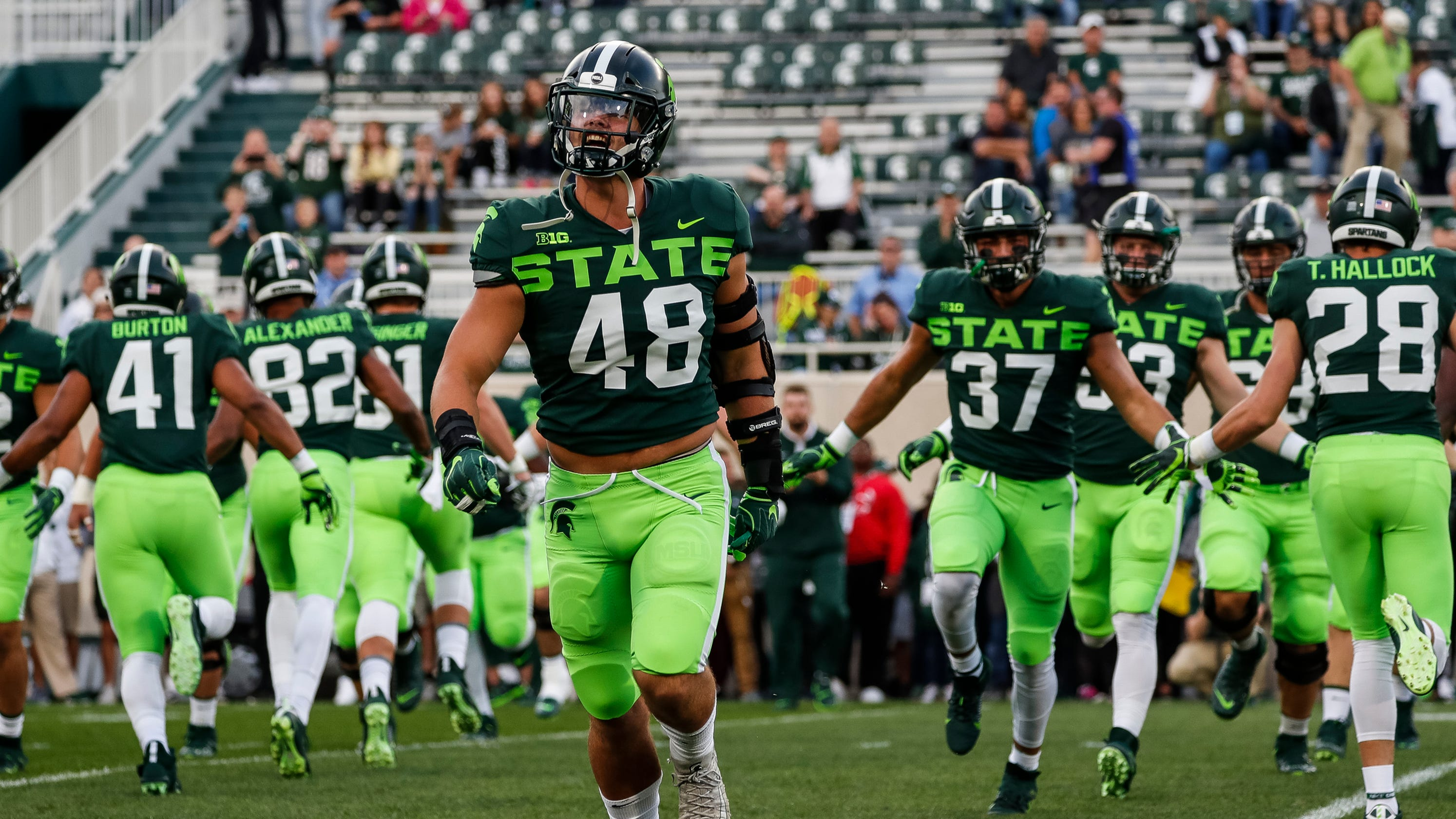 michigan football state uniforms neon social college spartans sports uniform green