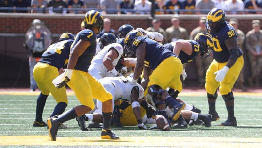 Michigan loses a third fumble to Army during the first half on Saturday, Sept. 7, 2019, at Michigan Stadium.
