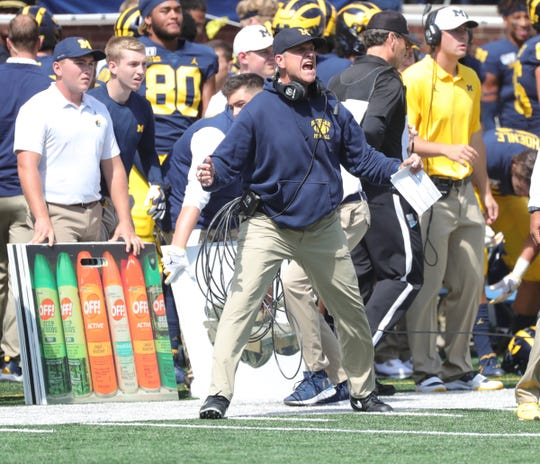 Michigan coach Jim Harbaugh disputes a call during the first half on Saturday, Sept. 7, 2019, at Michigan Stadium.