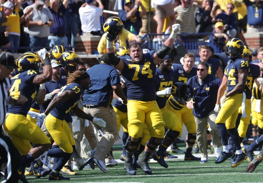 Michigan Wolverines Ben Brendeson (74) celebrates the 24-21 win against the Army Black Knights Saturday September 7, 2019 at Michigan Stadium in Ann Arbor, Mich.