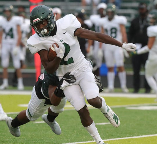 West Bloomfield Lakers' Jordan Hoskins tackles Birmingham Groves Falcons' Ralph Donaldson during the first half Friday, Sept. 6, 2019 at West Bloomfield high school.