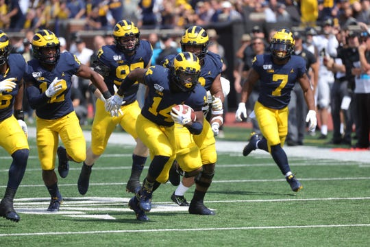 Michigan defensive back Josh Metellus recovers a fumble against Army during the first half on Saturday, Sept. 7, 2019, at Michigan Stadium.