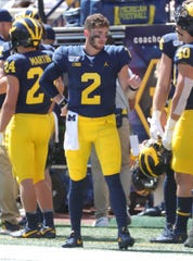 Michigan quarterback Shea Patterson on the side lines after a fumble against Army during the first half on Saturday, Sept. 7, 2019, at Michigan Stadium.