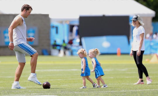 Detroit Lions quarterback Matthew Stafford has fun with his daughters Sawyer and Chandler while Kelly Stafford watches after training camp Wednesday, July 31, 2019 in Allen Park.