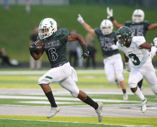 West Bloomfield Lakers' Donovan Edwards runs for a touchdown against the Birmingham Groves Falcons during the first half Friday, Sept. 6, 2019 at West Bloomfield high school.