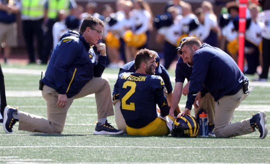 Michigan Wolverines quarterback Shea Patterson (2) gets attention during action against the Army Black Knights Saturday, September 7, 2019 at Michigan Stadium in Ann Arbor, Mich.