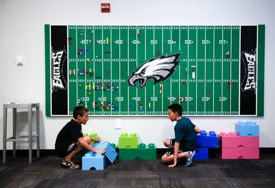 10-year-old twin brothers Ryan left, and Jack Ykoruk, play in the Lincoln Financial Field sensory room before a preseason NFL football game between the Philadelphia Eagles and the Baltimore Ravens in Philadelphia.