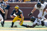 Michigan quarterback Shea Patterson is tackled in the second quarter.