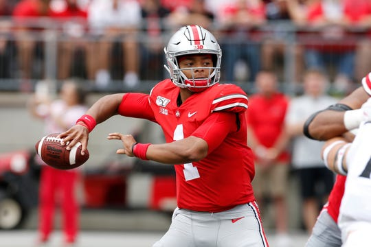 Ohio State's Justin Fields spots a receiver in the first half.