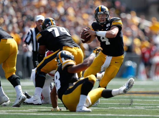 Iowa quarterback Nate Stanley runs the ball against Rutgers during the second half.