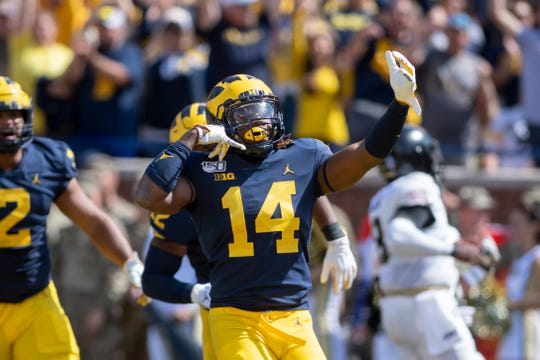 Michigan' Josh Metellus celebrates after recovering a fumble in the first quarter. Metellus had what appeared to be a touchdown off a fumble early in the fourth quarter called back.