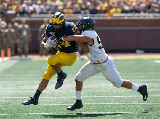 Michigan running back Zach Charbonnet picks up a first down in the second quarter.