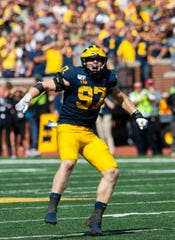 Michigan defensive lineman Aidan Hutchinson celebrates a stop in the second overtime.