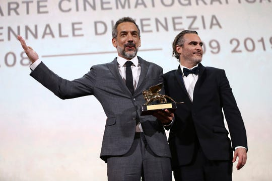 Director Todd Phillips, left, holds the Golden Lion for Best Film for 'Joker', joined by lead actor Joaquin Phoenix at the closing ceremony of the 76th edition of the Venice Film Festival, Venice, Italy, Saturday, Sept. 7, 2019.