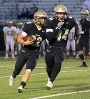 Max Freeman of Corning follows fullback Dillon Kennedy during a run against Vestal on Sept. 6, 2019 at Corning Memorial Stadium.