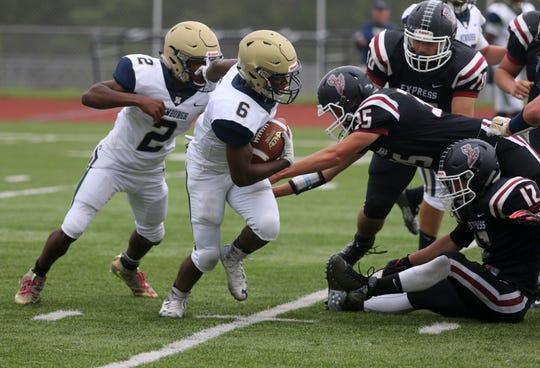Yasir Arnold of Newburgh carries the ball against Elmira on Sept. 7, 2019 at Ernie Davis Academy.