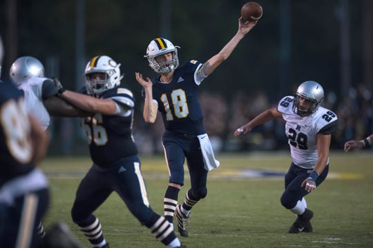 Castle's Nathan Harpenau (18) passes the ball during the Castle Knights vs Reitz Panthers game at John Lidy Field Friday evening, Sept. 6, 2019.