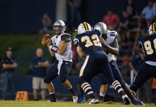Reitz's Reid Brickey (2) steps back to pass during the Castle Knights vs Reitz Panthers game at John Lidy Field Friday evening, Sept. 6, 2019.