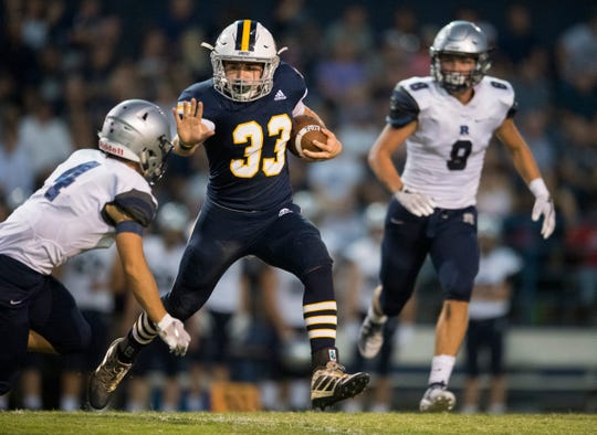 Castle's Adam Harpenau (33) carries the ball during the Castle Knights vs Reitz Panthers game at John Lidy Field Friday evening, Sept. 6, 2019.