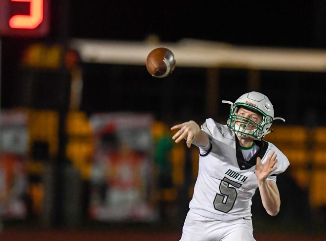 North's Ethan Brawdy (5) throws a second half pass as the North High Huskies play the Memorial Tigers at Evansville's Enlow Field Friday evening, September 6, 2019.