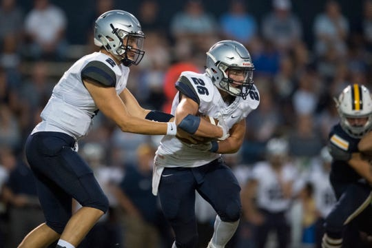Reitz's Reid Brickey (2) hands off to Reitz's Collin Brown (26) during the Castle Knights vs Reitz Panthers game at John Lidy Field Friday evening, Sept. 6, 2019.