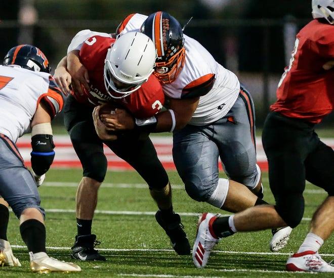 North Fond du Lac's Avery Hull tackles Lomira's Collin Yanke on Sept. 6.