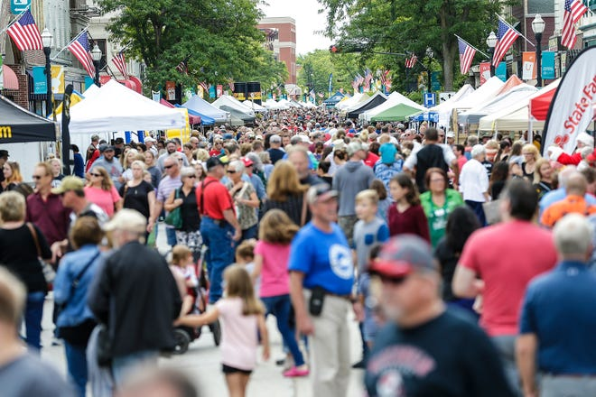 Thousands of people walk amongst over 200 vendors Saturday, Sept. 7, 2019, at Fondue Fest on Main Street in downtown Fond du Lac, Wis.