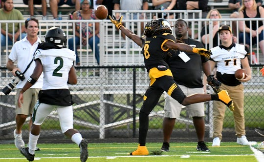Bishop Verot High School wide receiver Malik Curtis (8) reaches for an over thrown pass during their game with Palmetto Ridge High School in Fort Myers, Friday, Sept. 6, 2019.