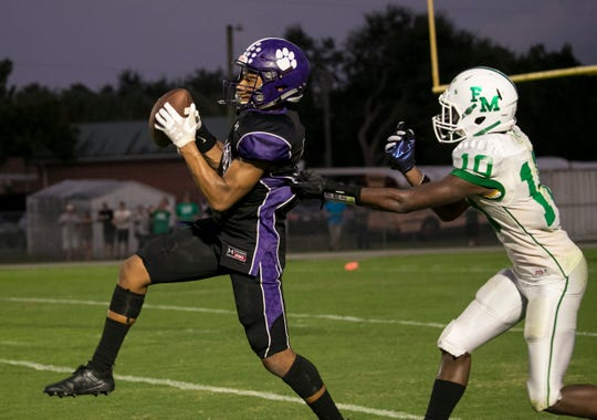 Kendal Battle of Cypress Lake gets an interception in front of Fort Myers receiver Joriell Washington in the second quarter of action on Friday, September 6, 2019, at Cypress Lake High School.