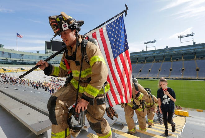 Corey Dahmen, of the Sun Prairie Fire Department, climbs the stairs in the bowl during the annual 9/11 Memorial Stair Climb Saturday, September 7, 2019, at Lambeau Field in Green Bay, Wis.