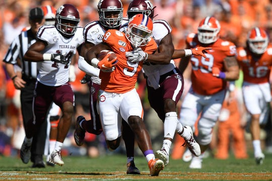 Texas A&M defensive back Demani Richardson (26) tackles Clemson running back Travis Etienne (9) during the second quarter at Memorial Stadium in Clemson, S.C., Saturday, Sept. 7, 2019.