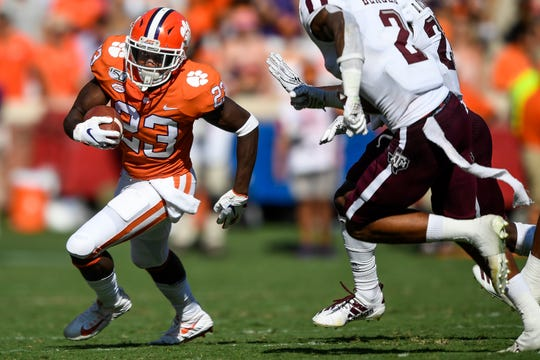 Clemson running back Lyn-J Dixon (23) advances against Texas A&M during the second quarter at Memorial Stadium in Clemson, S.C., Saturday, Sept. 7, 2019.