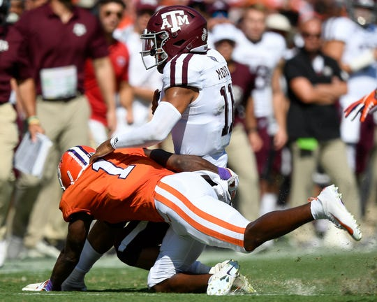 Clemson cornerback Derion Kendrick (1) tackles Texas A&M quarterback Kellen Mond (11) during the first quarter at Memorial Stadium in Clemson, S.C., Saturday, Sept. 7, 2019.