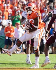 Clemson running back Lyn-J Dixon (23) celebrates his touchdown against Texas A&M during the third quarter at Memorial Stadium in Clemson, S.C., Saturday, Sept. 7, 2019.